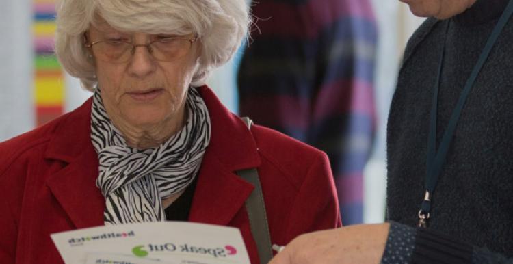 woman exploring sign posting leaflet