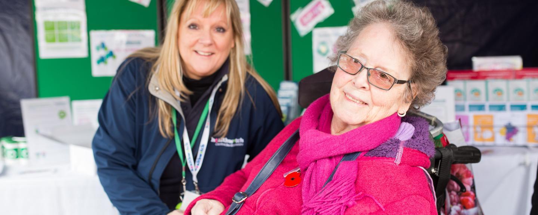 two women promoting Health watch